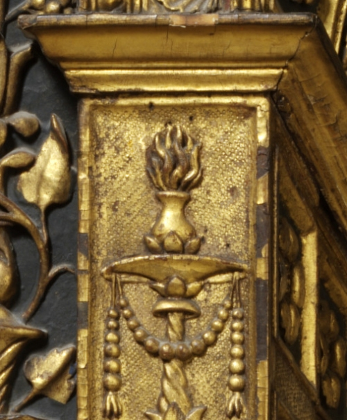 Candelabrum & torch on left inner pilaster