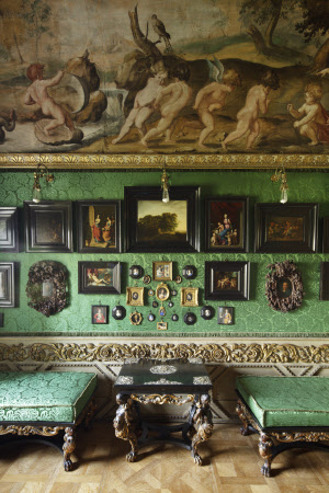 Collection of ebony-framed pictures and miniatures on the east wall of the Green Closet at Ham House, Surrey.