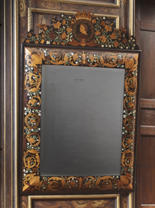 Wall mirror, 1675, of ebony, decorated with floral marquetry in various woods and ivory, at Ham House, Surrey.