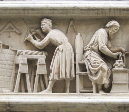 Nanni di Banco Two of the carvers from the predella panel of the Quattro Coronati 1411to13 Orsanmichele Commissioned by Guild of Sculptors & Woodcarvers