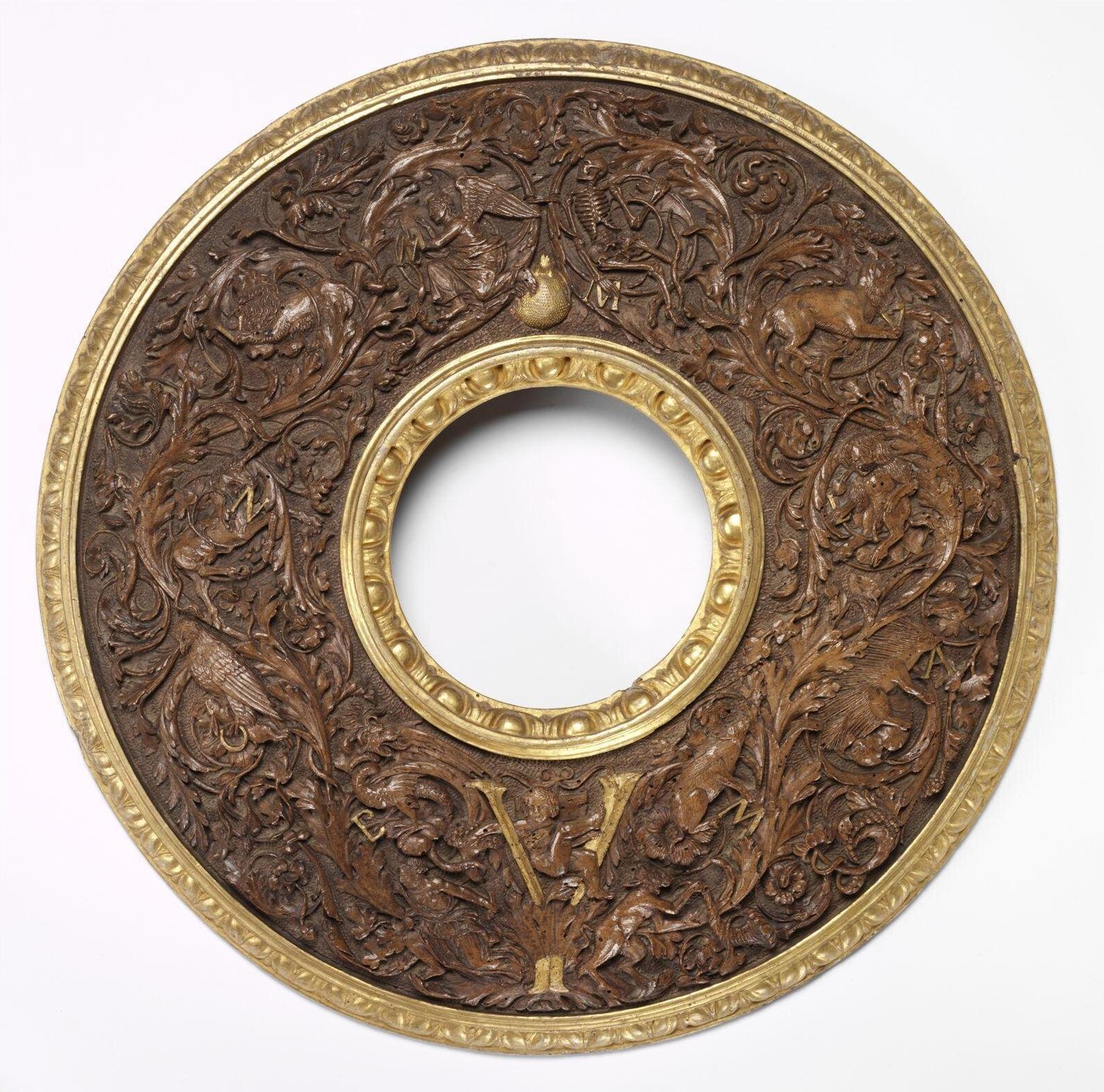 5 Ferrarese tondo looking glass frame c1490to1500 parcel gilt walnut 49cm diam V & A